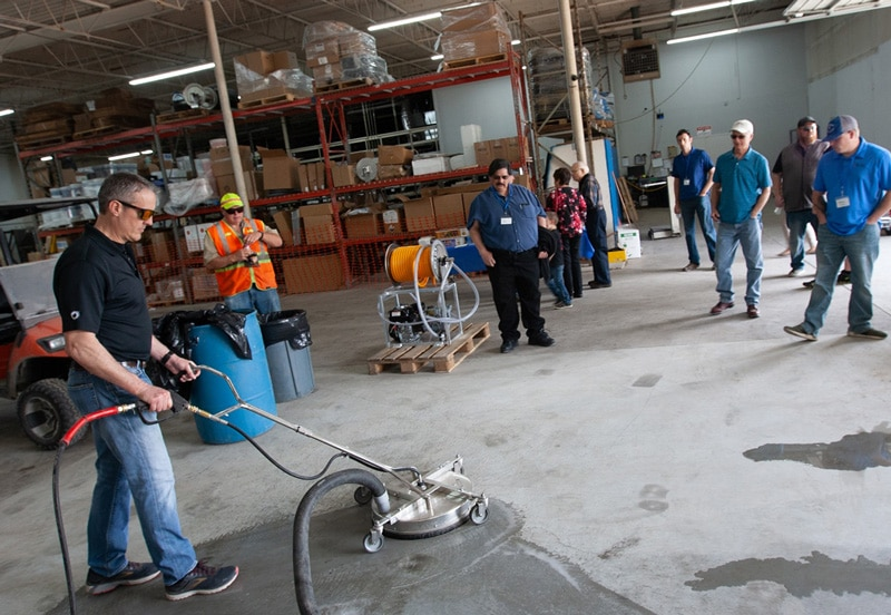 Mike Teaching Students how to use pressure washing equipment in class